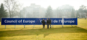 Cleaning team working to maintain the Council of Europe signage Stock Photo