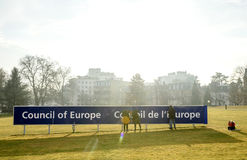 Cleaning team working to maintain the Council of Europe signage Royalty Free Stock Images
