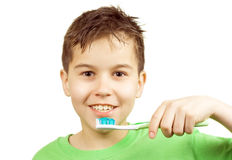 Cleaning teeth. Boy about to clean his teeth royalty free stock images