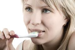 Cleaning teeth Stock Images