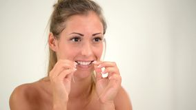 Cleaning Teeth With Dental Floss stock video footage