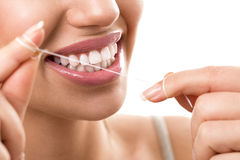 Cleaning teeth with dental floss royalty free stock images