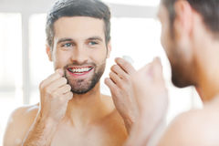 Cleaning teeth with dental floss. Royalty Free Stock Photography