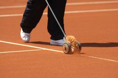 Cleaning tennis court royalty free stock images