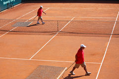 Cleaning of tennis court royalty free stock image