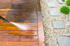 Cleaning terrace with a power washer Royalty Free Stock Image