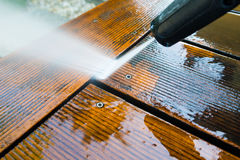 Cleaning terrace with a power washer Royalty Free Stock Images