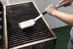 Free Cleaning The Grill Stock Photo - 29875080