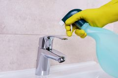 Cleaning The Water Tap Royalty Free Stock Photo