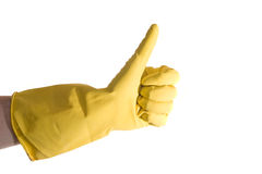 Cleaning Thumbs Up. Thumbs up with a yellow vinyl glove royalty free stock photos