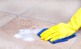 Cleaning tile with cloth Stock Photo