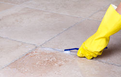 Cleaning tile grout with toothbrush Royalty Free Stock Photography