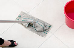 Cleaning of tiled floor Royalty Free Stock Images
