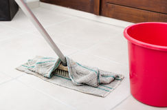Cleaning of tiled floor Royalty Free Stock Photos