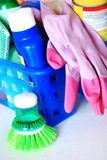 Cleaning time. Cleaning kit with brush, gloves and products Stock Photos
