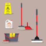 Cleaning time concept. There is a `Caution! Wet floor` sign and symbols of cleaning products  on a brown background in the picture. It can be used for the Royalty Free Stock Image