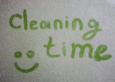 Cleaning time inscription on dusty surface Stock Images