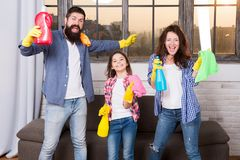 Cleaning together easier and more fun. Family care about cleanliness. Start cleaning. Cleaning day. Family mom dad and. Daughter with cleaning supplies at stock photos