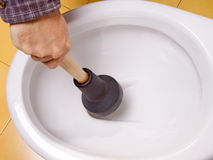 Cleaning toilet bowl Royalty Free Stock Photo