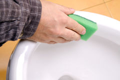 Cleaning toilet bowl Stock Photography