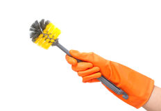 Cleaning toilet brush in hand  with orange glove Royalty Free Stock Photography