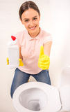 Cleaning the toilet Royalty Free Stock Images