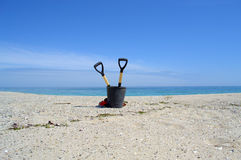 Cleaning tools on beautiful empty beach Royalty Free Stock Photos