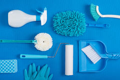 Cleaning tools blue background. Housecleaning stock photos