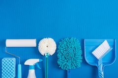 Cleaning tools blue background. Housecleaning stock image
