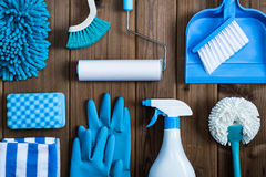 Cleaning tools blue background. Housecleaning stock photography
