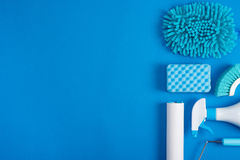 Cleaning tools blue background. Housecleaning royalty free stock image