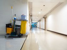Cleaning tools cart wait for maid or cleaner in the hospital. Bucket and set of cleaning equipment in the hospital. Concept of ser. Vice, worker and equipment royalty free stock images