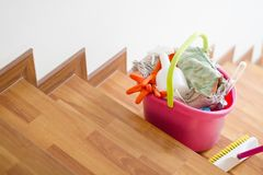 Free Cleaning Tools In Bucket On Stair Are Prepare To Cleaning Whole House Stock Photo - 125203080