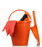 Cleaning tools in orange bucket Royalty Free Stock Photo
