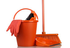 Cleaning tools in orange bucket Stock Photo