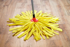Cleaning tools on parquet Stock Photography