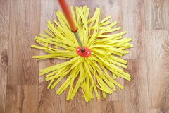 Cleaning tools on parquet floor. In a home royalty free stock photos