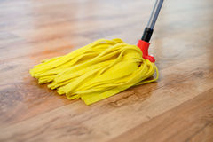 Cleaning tools on parquet floor Royalty Free Stock Photography