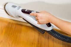 Cleaning Trim next to wooden floors stock photo