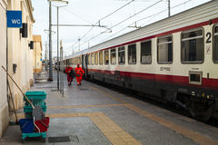 The cleaning trolley in the train station. Italy Royalty Free Stock Image