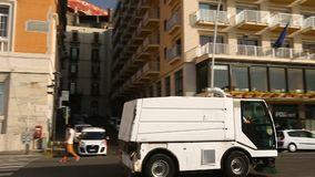 Cleaning truck driving down embankment road, service and ecology, cityscape. Stock footage stock video