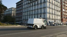 Cleaning truck driving on the road in the Naples city center, transportation. Stock footage stock video