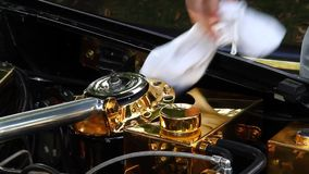Cleaning under car bonnet. stock footage