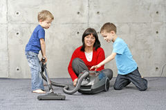 Cleaning up. Family have fun with cleaning carper - housework stock photos