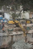 Are cleaning up the dirt of the excavator at the SHENZHEN construction site Royalty Free Stock Images