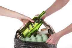 Cleaning up rubbish. Putting rubbish into plastic bag with garbage Stock Photo