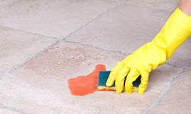 Cleaning up spill with sponge Royalty Free Stock Photography
