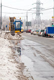 Cleaning up of streets from wet snow Stock Images