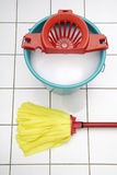 Cleaning utensils, Mop and bucket Royalty Free Stock Images