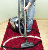 Cleaning by the vacuum cleaner Stock Photo